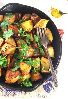 Golden Roasted Curry Mustard Potatoes | http://holycowvegan.net/2015/06/golden-roasted-curry-mustard-potatoes.html