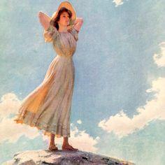 Mulher no topo de uma montanha