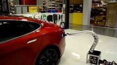 Watch Tesla's creepy 'solid metal snake' plug itself into a Model S