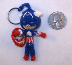 MINI Captain America Crochet Doll Keychain by PaintsAndNeedles  ||  Cap's shield is now the size of a quarter, and with a head the same size... He can no longer completely hide behind it.
