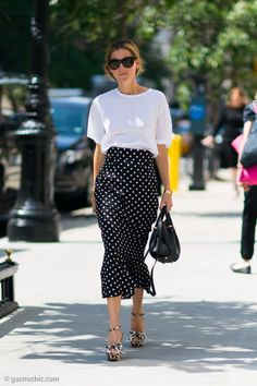 High-waisted swingy polka dot skirt paired with leopard-print platform sandals