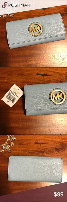 Michael Kors Leather Continental Wallet Blue Gold MICHAEL Michael Kors Leather Flap Continental Wallet in powder blue with gold MK signature initial emblem. New with all tags, never used. Shops fast from a smoke-free home. MICHAEL Michael Kors Bags Wallets