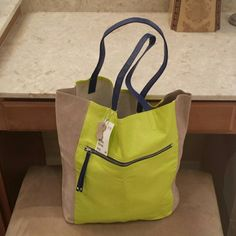 """NWT RARE leather neon colorblock H&M tote NEW WITH TAGS RARE leather neon green/yellow colorblock H&M tote Features a neon green panel on front and back, light tan sides 100% genuine leather, cobalt blue/silver zipper, cobalt blue handles. Great POP for the simplest outfit! Dimensions layed flat: 15""""H x 15""""L x 5.5""""W H&M Bags Totes"""