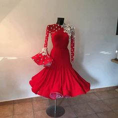 Red Ballroom Dance dress with  red lace sleeves with white lace spots, one with white appliques  on shoulder creating an asymmetric look. Horsehair braid on hem