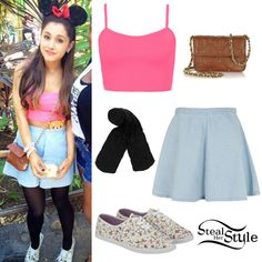 She wore a Bralet Crop Top ($12.00),  the MOTO Black Acid Swing Skirt ($56.00) and Opaque Tights ($12.00) all from Topshop. She teamed the look with a Frankie Quilted Leather Crossbody Bag by Juicy Couture ($128.00) and a pair of Urban Outfitter Floral Plimsolls (Sold Out). You can find similar plimsolls for $45.00 by Keds.