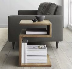 a side table that's also a desk and magazine rack