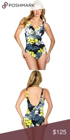 New! Magicsuit Ruched Slimming?One-Piece Swimsuit This one piece from Magicsuit by Miraclesuit offers a slim and sassy silhouette, thanks to its slenderizing side ruching and supportive bust line with padded cups. A plunge back is a flirty detail.   MAGICSUIT BY MIRACLESUIT! Plunge v-neck with center?ruchingand adjustable tie Innovative Miratex fabric boasts an increased Lycra content for a slim silhouette Lightly padded cups Shirred bodice contour torso to showcase your glamorous shape Low…