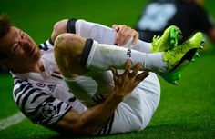 Juventus' Swiss defender Stephan Lichtsteiner falls after being tackled by Porto's Brazilian defender Alex Telles during the UEFA Champions League round of 16 second leg football match FC Porto vs Juventus at the Dragao stadium in Porto on February 22, 2017. / AFP / MIGUEL RIOPA