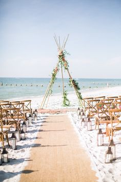 beach wedding The ceremony took place on the beach, marked by a teepee-style focal point adorned with fresh flowers in the muted tropical palette, and topped with antlers. Beach Wedding Attire, Beach Wedding Reception, Beach Wedding Flowers, Beach Ceremony, Beach Wedding Decorations, Summer Wedding, Wedding Events, Wedding Ceremony, Wedding Ideas
