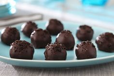This is the stuff that dreams are made of: Oreo Cookie crumbs are blended with cream cheese and covered with a chocolate shell for the best-tasting truffles ever.