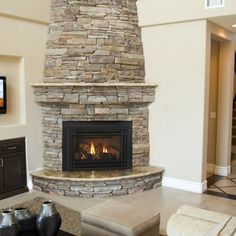 Are you lucky enough to have a living room with fireplace? A fireplace is an architectural structure designed to contain a fire. The idea of a corner fireplace living room is amazing. Corner Wood Stove, Corner Stone Fireplace, Corner Electric Fireplace, Fireplace Hearth, Home Fireplace, Fireplace Remodel, Fireplace Inserts, Living Room With Fireplace, Fireplace Surrounds