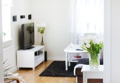 A clean white living room with white and black decor via o h s t l i n . s e #interior #spaces #home #decoration #design