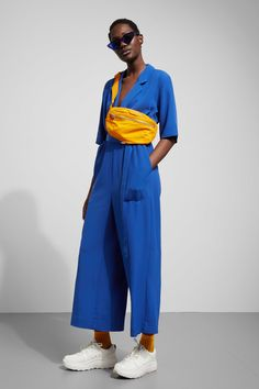 The Jimi Jumpsuit has a V-shaped neckline and a belted waist for a flattering fit. It has short sleeves and cropped wide legs. - Size Small measures 112 cm in chest circumference and inseam. Jumpsuit With Sleeves, Jumpsuit Dress, Black Jumpsuit, Youth Culture, Fashion Brand, Short Sleeves, Street Style, How To Wear, Pants