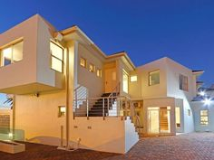 Indigo Bay - Indigo Bay is located in an upmarket suburb named Camps Bay in Cape Town. There are four modern apartments plus a ground-level house with sweeping views of the Atlantic Ocean and Twelve Apostles mountains.