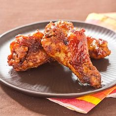 Slow-Cooker Sticky Wings, Bacon-Cheddar Potato Skins, Creamy Herbed Spinach Dip, Roasted Sweet Potato Wedges, open-Faced Sausage Sandwiches, Peanut Blossom Cookies, Chewy Brownies