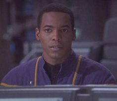 Ensign Travis Mayweather played by Anthony Montgomery