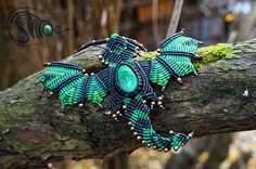 Dragon pendant with malachite and metal beads by Helen Aki