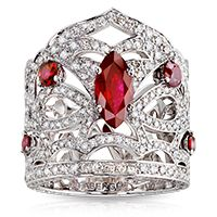 Fabergé Kokoshnik Ring    This piece is set in 18 carat white gold and features 436 diamonds and rubies totalling 5.41 carats.