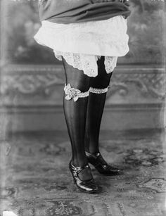 Image of a woman modeling stockings, garters and shoes. Published in Ladies Field.    Maker:  Bassano Studio  Production Date:  1922-10-25