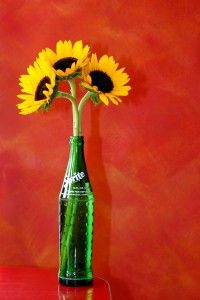 Use a Glass Soda Bottle as a Vase Use an old soda bottle for weddings.