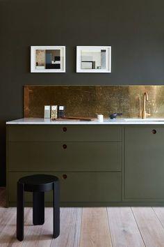 Olive dark green kitchen with brass backsplash