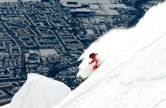 Swedish freeride skier Jon Oerarbaeck speeds down deep powder snow during a freeride skiing tour on Seegrube Mountain in Innsbruck on January 19, 2013.