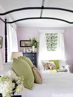 The vinyl shades are papered in Pierre Frey's Espalier. The canopy bed was painted black to show off its silhouette.