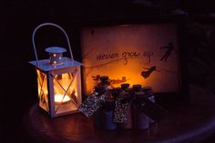 """""""Never Grow Up"""" Peter Pan themed favour table with pixie dust favour bottles from our Peter Pan-themed backyard wedding stylized photoshoot"""