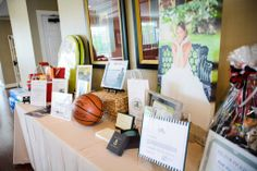 Auction items table from the May 12th Young Life Louisa event hosted by Spring Creek Golf Club in memory of Tom Garrett, a graduate of the University of Richmond and committed supporter of both Spider athletics and Young Life.