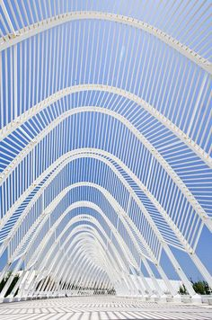 Greece, The Olympic Agora by Santiago Calatrava is comprised of 99 parabolic arches linked to form a ceremonial route across the Athens Olympic site Art Et Architecture, Futuristic Architecture, Beautiful Architecture, Beautiful Buildings, Contemporary Architecture, Architecture Details, Greece Architecture, Installation Architecture, Pavilion Architecture