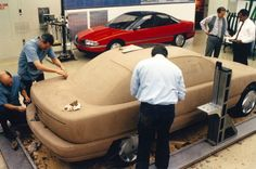 1991 Oldsmobile Achieva clay model and fiberglass model in background