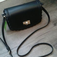 HP Kate Spade ♠ black purse ♠Zani black leather purse. Gold clasp with black liner. Very cute purse has one big open area with two card slots. There is a flap to cover the top and it has a very cute ruffle design on the side. Purse can be used as a shoulder bag or cross over HP 5/30 STYLE STAPLE PARTY chosen by @angieleah  kate spade Bags Satchels