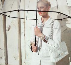 Chanel. Love the umbrella and bag!