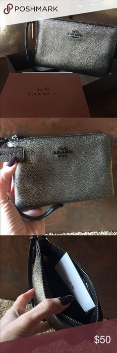 Authentic gold and black Coach wristlet Authentic gold and black Coach wristlet. Brand-new. Comes with receipt and box. Coach Accessories