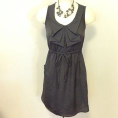 Gray Short Dress Sleeveless dress with full elastic waistband and has two side pockets. 100% polyester. BeBop Dresses