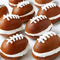 Pumpkin Football Cakes - Score big at your next tailgate or game-day party with irresistible pumpkin-cake whoopie pies with butter cream frosting.