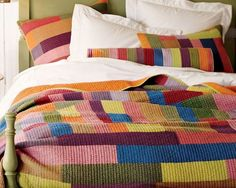 "yum - kantha quilt, Indian  A modern color block quilt from Pottery Barn. The Kantha Quilt and Sham is made using Indian Kantha embroidery, which PB describes as ""layers of cotton voile pieced together with tiny pick stitches""."