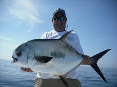 Captain Jason Swensson with a slob of a permit. #keylargopermit