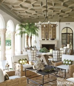 The geometric wooden ceiling of this Spanish- and Moroccan-inspired desert home complements the rope chairs from John Himmel Decorative Arts and Moroccan coffee table. - Veranda.com