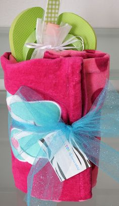 love this idea for tween girls and even teacher gift...in a drawstring bag, put an emory board, small nail polish remover and a bottle of nail polish.  Buy some flip flops and a cute beach towel, fold flip flops and bag of nail polish, etc in towel and use tulle to tie around towel.  It would be really cute to make fun, ribbon flip flops!