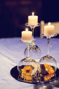 wine glass used as candle holder. put a flower or decoration under. @Meg Wheeler wedding decor?