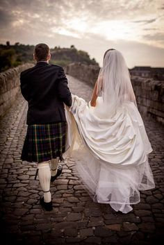The groom assists his bride with her dress as they walk over a ancient Stirling bridge Dunblane Hydro, Stirling Castle, Free To Use Images, Wedding Images, High Quality Images, Groom, Wedding Day, Wedding Photography, Bride