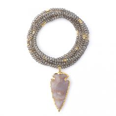 Obsessed. Smoky Topaz & Arrowhead necklace by Gold & Gray jewelry via the blog A Piece of Toast