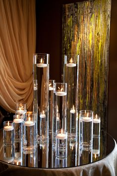 Candlelight, love the clear vases, use of water and candles, but dislike the background in this photo
