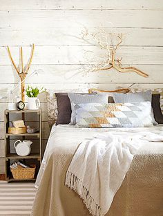 Using nature as art gives an organic and trendy feel to your home. More decorating with natural elements: http://www.bhg.com/decorating/seasonal/fall/decorating-with-natural-elements/?socsrc=bhgpin052913branch=10 Love the bedside table and walls