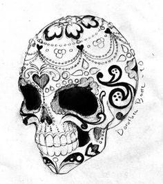 Photo : Idée de tatouage: crâne mexicain stylisé avec fleurs