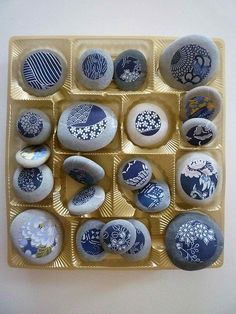 blue designs on gray pebbles