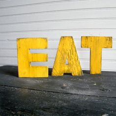 EAT Word Sign Yellow