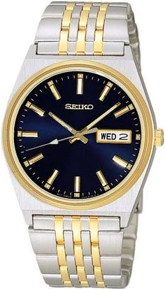 Seiko SJN050 Mens Blue Dial Two Tone Dress Watch Seiko. $99.00. Stainless Steel Case and Band with Fold Over Deployment Clasp. Case Size:  34mm Diameter, 8mm Thickness. Hardlex Mineral Crystal, Day/Date Display with Spanish Option, Luminous Hands and Markers. Gold Hands and Index, Water Resistant - 30M. Precise Quartz Movement