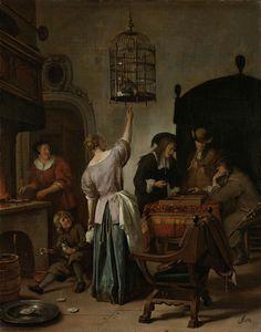 Jan Havicksz. Steen | Interior with a Woman Feeding a Parrot, Known as 'The Parrot Cage', Jan Havicksz. Steen, c. 1660 - c. 1670 | Interieur met een jonge vrouw, die een papegaai voert, twee triktrakspelers en andere figuren. Voorstelling bekend als 'De papegaaiekooi'. Links bakt een vrouw oesters op een fornuis, op de grond zit een jongen die met een lepel een kat voert. De vogelkooi met geopend deurtje hangt aan het plafond.